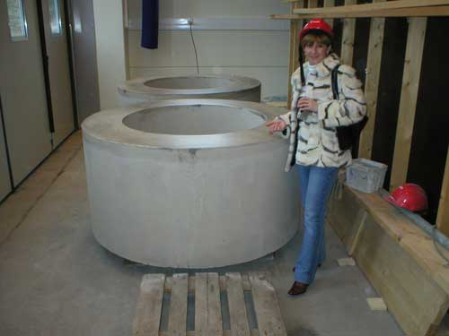Daniela Diaconu, INR, next to a concrete  mock-up of a bentonite ring which goes around the copper waste canister in the vertical disposal boreholes.