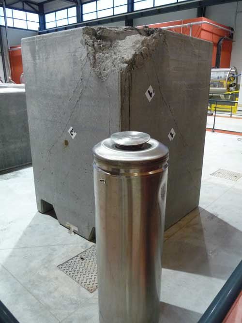 A waste canister and concrete  container at Bure visitor centre. The damage is due to test where this block was dropped from several meters without being penetrated.