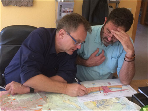 Figure 2. Klaus and Pete assessing what confidence and certainty can be placed upon published interpretations of KVC faults and lithologic units, before they can be used as foundation for our model.