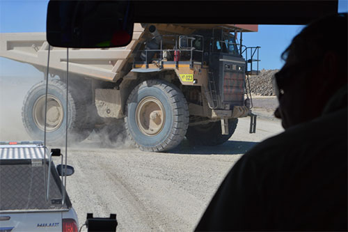 Photo 4. Give Way! to the house-sized truck delivering another load of gold ore to the feedstock pile.