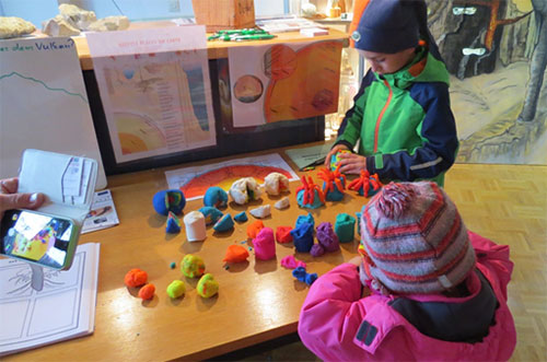 Children learning about the Earth at the Kaiserstuhl Open Day.