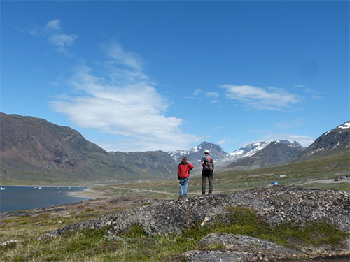 Michael Marks and Gregor Markl admiring the distant Greenland Minerals and Energy deposit at Kvanefjeld, from the town of Narsaq.