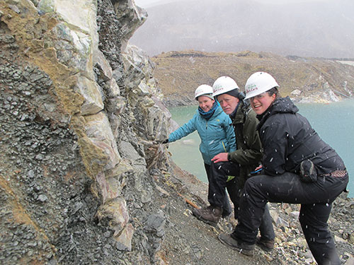 Participants (L to R) E. Deady, G. Gunn (both BGS) and H. Elliott (CSM) admiring fenite in the snow at Ledmore Marble Quarry.
