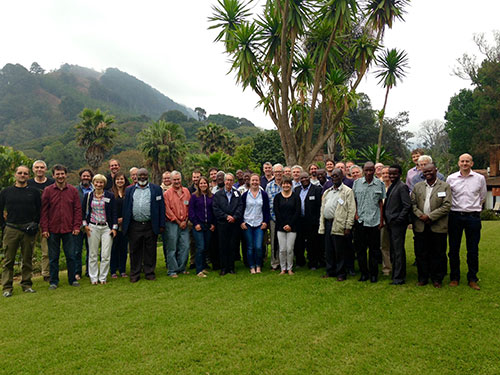 Group photo of HiTech AlkCarb workshop attendees in gardens of Sunbird Kuchawe Hotel.