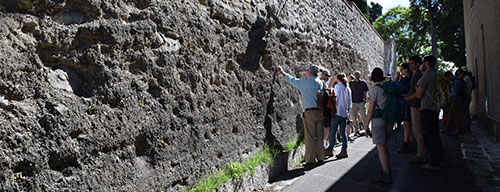 Prof. Stoppa leads a discussion about the San Venanzo complex at a wall in the town which is built upon part of the pyroclastic material from one eruption.