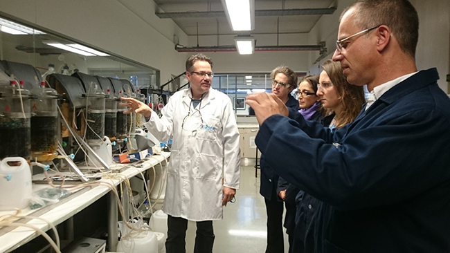 Visiting UCT labs, with Jochen Petersen. Photo Copyright Kathryn Goodenough